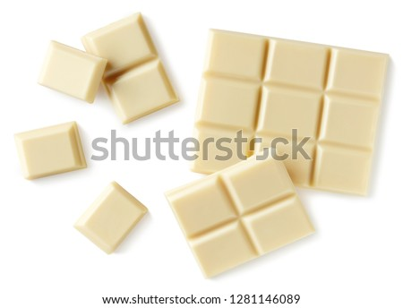 White chocolate pieces isolated on white background. Top view #1281146089