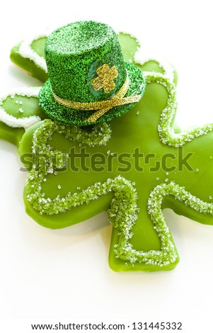 White chocolate shorrbread cookies in shape of four clover leaf for St. Patrics Day.