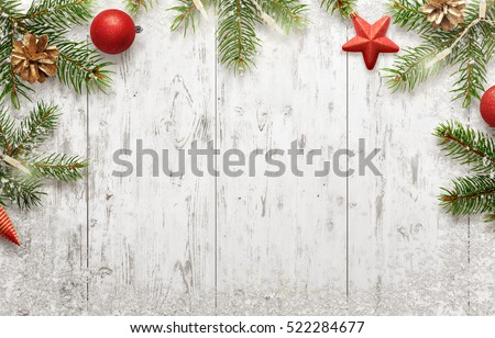 White Christmas background with tree and decorations. Lights, ball, pine cone beside. Top view with free space for greeting card text. #522284677