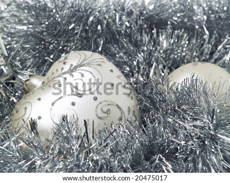 White christmas decoration balls on bright background
