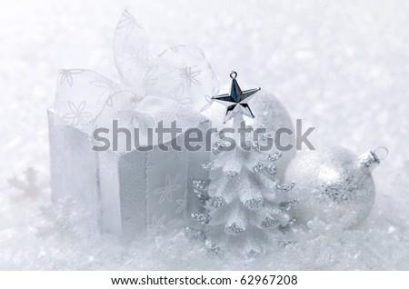 White christmas decoration on white snow background
