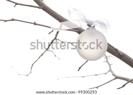white christmas ornament hanging on a christmas tree