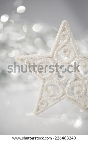 White christmas star on bokeh lights background with space for text.