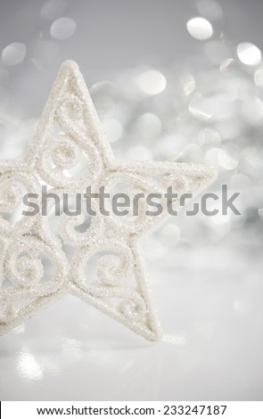 White christmas star on bokeh lights background with space for text. Merry christmas card. Winter holidays. Xmas theme.