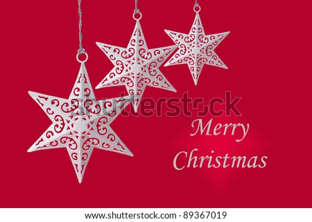 White Christmas star ornament on red background, with Merry Christmas text