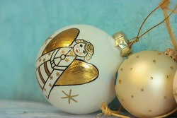 White Christmas tree ball with gold angel, blue background, festive decor
