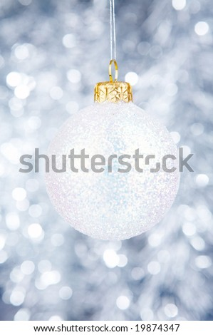 White Christmas-tree decoration on a silvery background