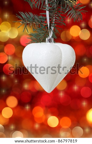 White Christmas tree decoration on lights background - stock photo