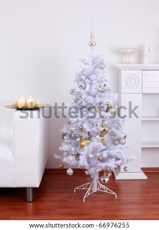 White Christmas tree in white tone at home