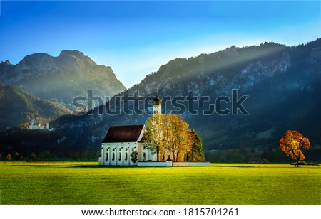 White church in mountain valley. Church in mountains. Mountain church view. White church in mountains
