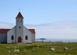 white church with red roof on Ile aux Marin, Saint Pierre and Miquelon