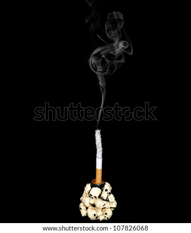 White cigarette in a candlestick decorated with human skulls