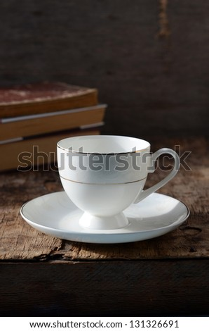 White circle on a wooden table with books