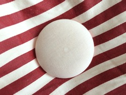 white circle pins on red stripe fabric background