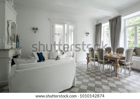 White classical living room interior with large dining table #1010142874