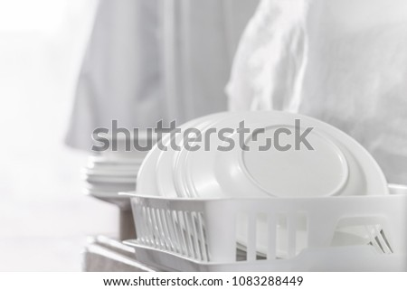 White clean dish on a dish rack #1083288449