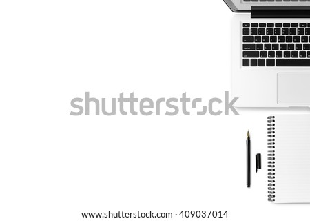 White clean office desk with laptop, notebook and pen. Top view with copy space.