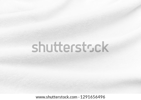 White clean soft smooth fleece fabric blanket texture with curves, creases and folds. For background and wallpaper with room for text and copy space. Photo stock ©