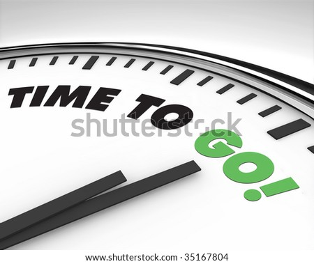 White clock with words Time to Go on its face - stock photo
