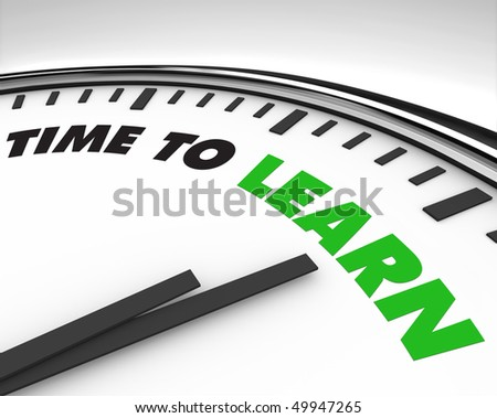 White clock with words Time to Learn on its face - stock photo