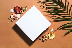 White close square gift box mockup template top view. Layout package presentation clipart. Tropical seashells decor, palm tree leaf. Summer trendy flat lay on brown beige background