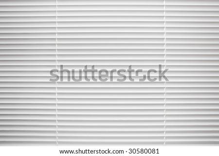 White closed jalousie at day illumination