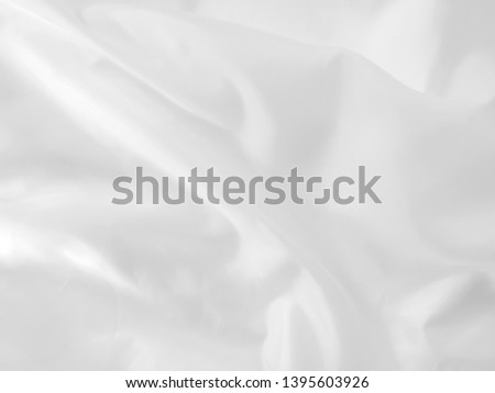 White cloth abstract background soft waves.Texture,background,pattern.White fabric background abstract with soft waves. #1395603926