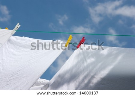 White clothes drying on the rope