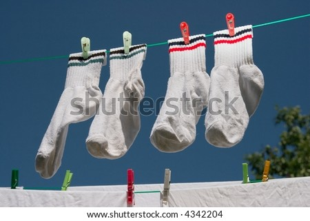 White clothes hung out to dry under clear blue sky