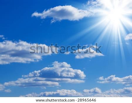 White cloud and sun in a blue sky