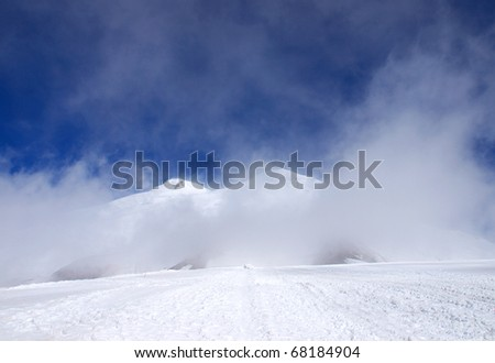 White cloud in snow mountain high. Natural composition