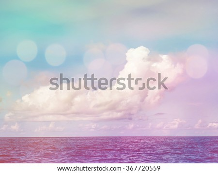 White cloud on blue sky over ocean surface, vintage filter effect,double exposure stylized