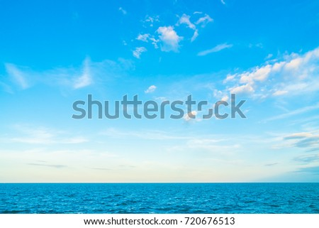White cloud on blue sky with sea and ocean background
