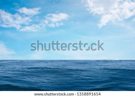 white cloud on Ocean sea waves nature surface and blue sky for background #1358891654