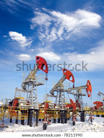 White clouds above oil field. Oil and gas industry
