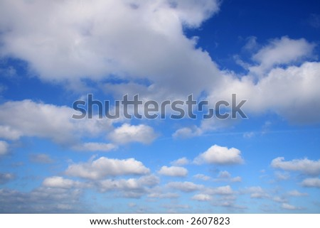 White clouds and blue sky background. - stock photo