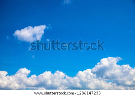 White clouds chain below blue sky. Sunny cloudscape photo background. Skyscape with fluffy cloud. Fluffy cloud on sunny sky. Climate or weather change. Harmony concept. Fluffy cloud abstraction #1286147233