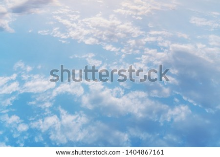 white clouds float across the blue sky, atmospheric shot #1404867161