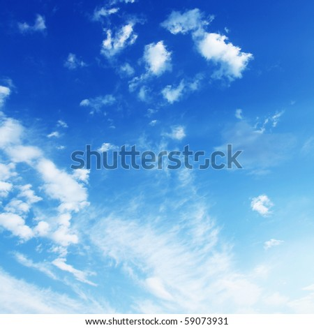White clouds in a blue sky.