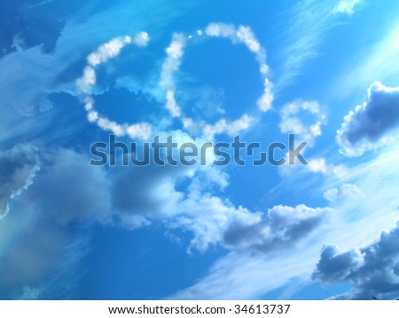 white clouds in a clear blue sky with co2