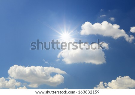 White clouds in dark blue sky background - Shutterstock ID 163832159