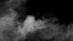 White clouds of vapor smoke are isolated on a black background. Gas explodes, swirl and dances in space. A magic fog dust texture effect that can be used by overlay and changing their transparency.
