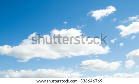 white clouds on a blue sky day - Shutterstock ID 536646769