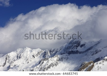 white clouds on a snowy mountain in the Pyrenees, Spain