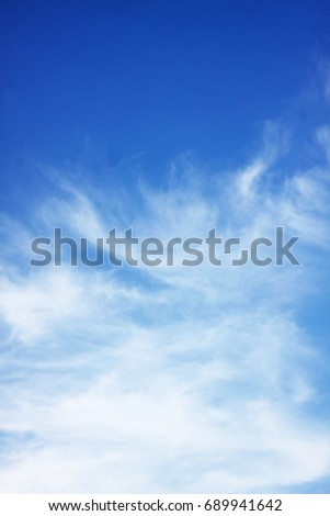 white clouds on blue sky - Shutterstock ID 689941642