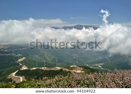 White Clouds over Green Hills and Wind Mills