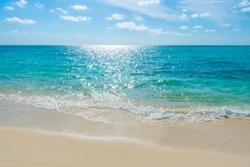 White clouds with blue sky  over calm sea beach in tropical Maldives island