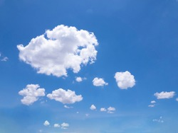 White clouds with bright sky, backdrop