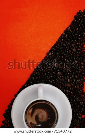white coffee cup and beans on red background