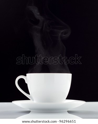 White coffee cup over black background